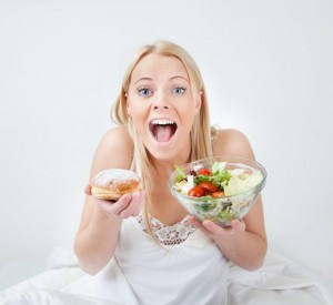 tempted-young-woman-making-a-food-choice.jpg
