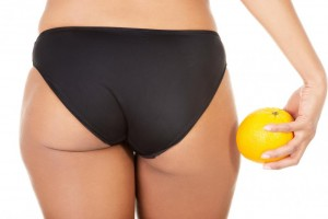 a-girl-holding-an-orange-next-to-the-buttocks.jpg